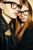 Eyewear concept. Family portrait of gorgeous blond fashion twins — Stock Photo