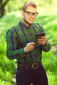 Gadget freak concept. Portrait of a funny hipster in casual clot — Stock Photo