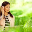 Happy fashionable hipster girl in pink leather jacket listening — Stock Photo #46688713