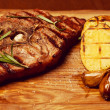 Succulent thick juicy portions of grilled fillet steak with bone — Stock Photo #47532137