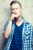 Crazy hipster concept. Emotive portrait of young man in casual b — Stock Photo