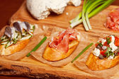 Set of toasts with fresh and pickling cucumber, goat cheese, ita — Stock Photo