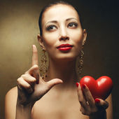 Signs and symbols of love concept. Portrait of model with great — Stock Photo