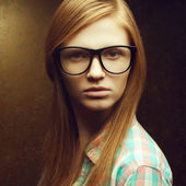 Portrait of young beautiful red-haired hipster girl wearing tren — Stock Photo