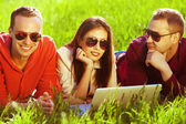 Useful weekend concept. Three happy friends having fun in park — Stock Photo