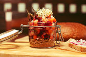 Mason jar with pieces of vegetables (carrot, onion, capers, red  — ストック写真