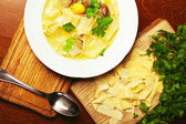 Chicken soup with pasta (noodle) with fresh parsley on a wooden — Stock Photo