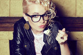 Eyewear concept. Portrait of a funny hipster blonde girl — Stock Photo