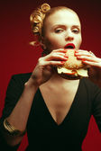 Fashion & Gluttony Concept. Portrait of luxurious red-haired model — Stock Photo