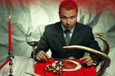 Baroque supper of blue blood aristocrat a-la Hannibal Lecter. Ha — Stock Photo