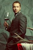 Emotive portrait of handsome stylish man in elegant dark gray su — Stock Photo