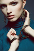 Ethnic accessories concept. Portrait of beautiful young woman in — Stock Photo