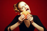 Fashion & Gluttony Concept. Happy red-haired model in black cock — Stock Photo