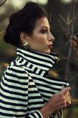 Emotive profile portrait of Hollywood diva, film star walking in — Stock Photo