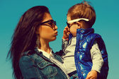 Eyewear concept. Portrait of fashionable baby boy & his gorgeous — Stock Photo