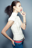 Portrait of fashionable beautiful young woman in trendy clothing — Stock Photo