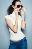 Eyewear concept. Fashionable beautiful young woman in trendy clo — Stock Photo