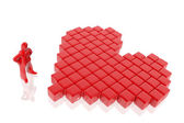 Figure constructing a heart with cubes — Stock Photo