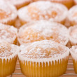 Baked cupcakes with dusting of icing sugar on top. — Stock Photo #12718547
