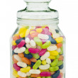 Jelly beans in a candy glass jar — Stock Photo