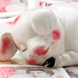 Sleeping Piggy Bank On A Bed Of Money — Lizenzfreies Foto