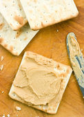 Peanut butter spread on crackers. — Stock Photo