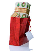 Red Gift Bag Overflowing With Christmas Presents. — Stock Photo