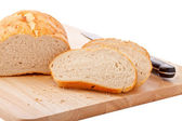 Bread on chopping board isolated on white — Stock Photo