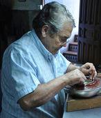 Old craftsman — Stock Photo