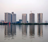 Building lake reflection — Stock Photo