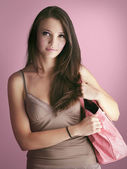 Girl in pink bag — Stock Photo