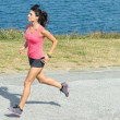 Woman running fast on summer — Stock fotografie