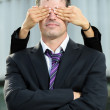 Stock Photo: Cover business man eyes