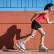 Stock Photo: Female roller skater