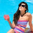 Stock Photo: Drinking refreshment at poolside