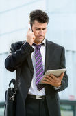 Business man with phone and tablet — Stock Photo
