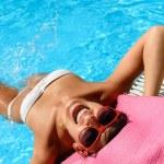 Funny woman in pool — Stock Photo #12890220