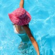 Playful lady in pool - Stock Photo