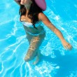 Walking in swimming pool - Stock Photo