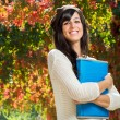 Stock Photo: Happy student in autumn
