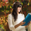 Student and notebook in autumn — Stock Photo