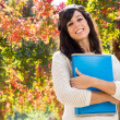 Cute student in autumn — Stock Photo