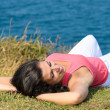 Woman relaxing in summer towards the sea — Stock Photo