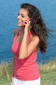 Walking and using phone in summer — Stock Photo