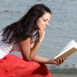 Woman feeling tranquility reading a book — Stock Photo