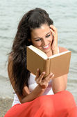 Dreamy reader in beach — Stock Photo