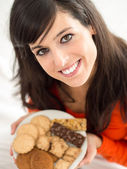 Woman with delicious biscuits — Stock Photo