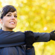 Woman stretching shoulder — Stock Photo #14802391