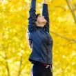 Woman in shape exercising outside — Stock Photo