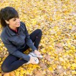 Girl stretching legs in autumn — Stock Photo